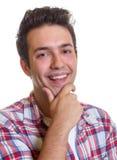 Laughing hispanic guy Stock Image