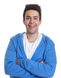 Laughing hispanic guy in a blue hoody Royalty Free Stock Images