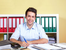 Laughing hispanic guy at his office Stock Images