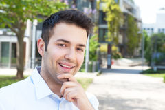 Laughing hispanic male student looking at campus Stock Photos