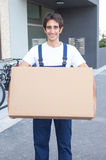 Laughing hispanic worker with box Stock Image