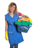 Laughing housewife with blond hair and a basket of clothes Royalty Free Stock Images