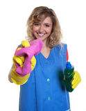 Laughing housewife with blond hair and damp cloth Stock Image