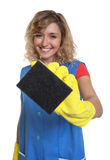 Laughing housewife with blond hair and sponge Royalty Free Stock Images