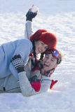 Laughing husband and wife having snowball fight royalty free stock image