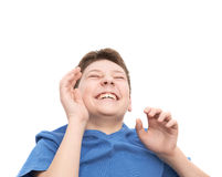 Laughing hysterically young boy isolated Stock Images
