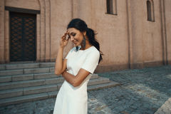 Laughing indian lady in white dress against ancient building Royalty Free Stock Photos