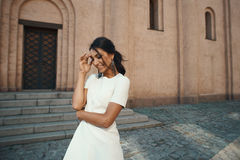 Laughing indian lady in white dress against ancient building Royalty Free Stock Image