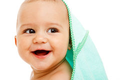 Laughing infant. Covered with towel Royalty Free Stock Photo