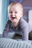 Laughing infant boy looking at camera. Open mouthed smiling toddler kid. Royalty Free Stock Photography