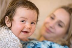 Laughing infant Stock Photography