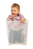 Laughing kid in a box Royalty Free Stock Photos