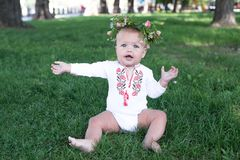Laughing kid girl 1 year old having fun outdoors stock images