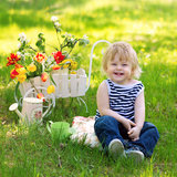 Laughing kid on the grass in the garden royalty free stock photo