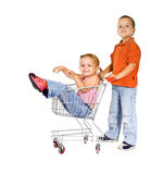 Laughing kids with shopping cart Royalty Free Stock Image