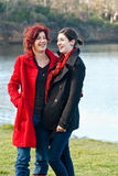 Laughing Ladies in Coats royalty free stock photo