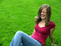 Laughing lady. Young woman/girl close up, outside in the grass laughing Stock Photos