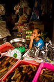 Laughing lady selling sea slugs in Jakarta, Indonesia Stock Photo