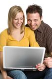 Laughing Laptop Couple Royalty Free Stock Photo