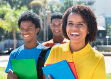 Laughing latin american female student with friends Royalty Free Stock Photography
