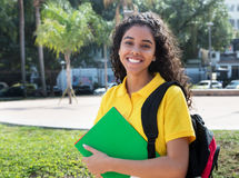 Laughing latin american female student with long dark hair Royalty Free Stock Photo