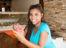 Laughing latin american woman with ice cream. Outdoor in the summer in the city Royalty Free Stock Photos