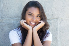 Laughing latin american woman with long hair. Outdoor in the summer Royalty Free Stock Images