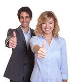 Laughing latin business team showing thumb up Stock Photos