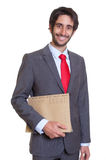Laughing latin businessman with file Royalty Free Stock Photos