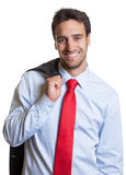 Laughing latin businessman with red tie after work Royalty Free Stock Images