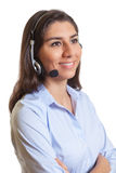 Laughing latin businesswoman with headset Royalty Free Stock Images