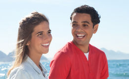 Laughing latin couple at beach Royalty Free Stock Photography