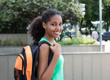 Laughing latin female student with bag in the city Stock Photography