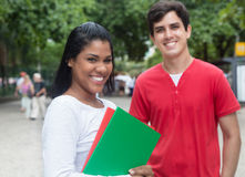Laughing latin female student with caucasian friend outdoor Royalty Free Stock Photos