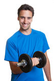 Laughing latin guy with dumbbell Royalty Free Stock Photo