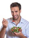 Laughing latin man with fresh salad Stock Photo