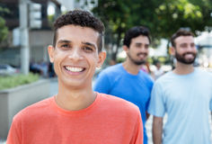 Laughing latin man with two friends in city Royalty Free Stock Photography