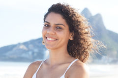 Laughing latin woman with curly hair at beach at Rio de Janeiro Royalty Free Stock Image