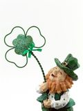 Laughing Leprechaun. Leprechaun figure with Shamrock royalty free stock images