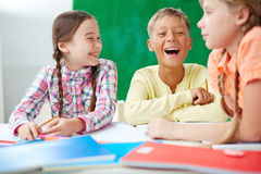 Laughing at lesson Stock Images
