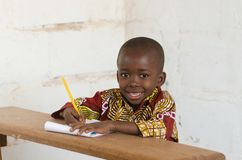 Free Laughing Little African School Boy Sitting In Desk Smiling At Ca Stock Image - 108245751