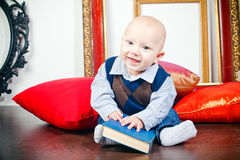 Laughing Little Baby With Book Stock Photography