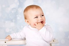 Laughing little baby boy. Studio portrait of happy children face Royalty Free Stock Images