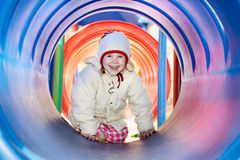 Laughing little baby girl in tube Stock Photography