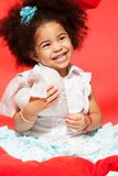 Laughing little black girl. Holding toy white heart in her hands Royalty Free Stock Photos