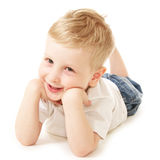Laughing little boy. Laying on floor Royalty Free Stock Images