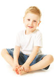 Laughing little boy. Sitting on floor Royalty Free Stock Image