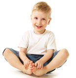 Laughing little boy. Sitting on floor Stock Image