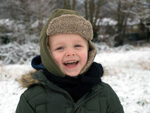 Laughing little boy. In the winter cold day stock images
