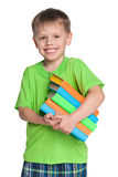 Laughing little boy with books Stock Image